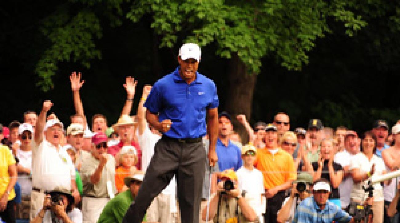Tiger Woods's lone highlight came at No. 14 when he bladed a sand wedge in for birdie.