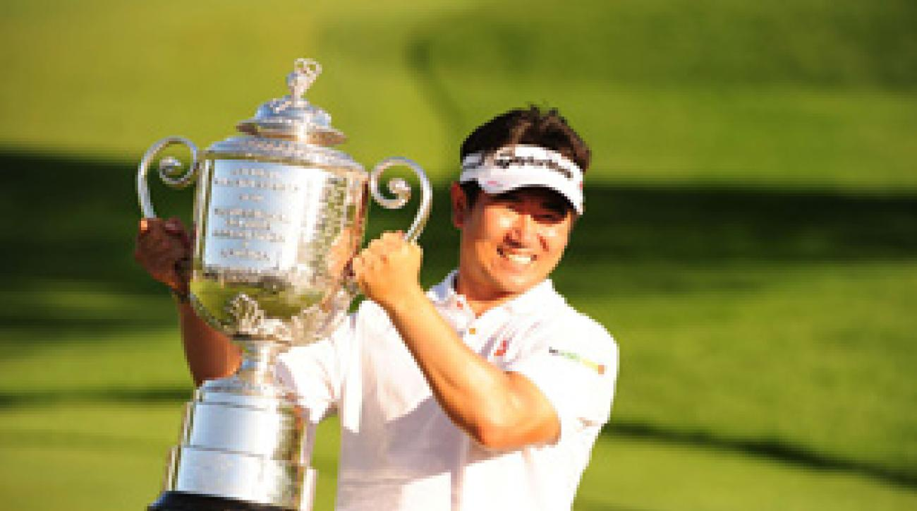 Y.E. Yang defeated Tiger Woods by three strokes to become the first Asian-born player to win a major.
