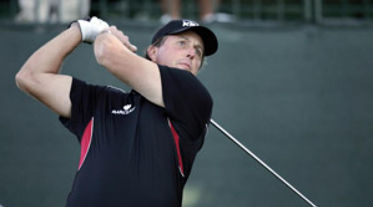 Phil Mickelson starts the playoffs in second place behind Kenny Perry.