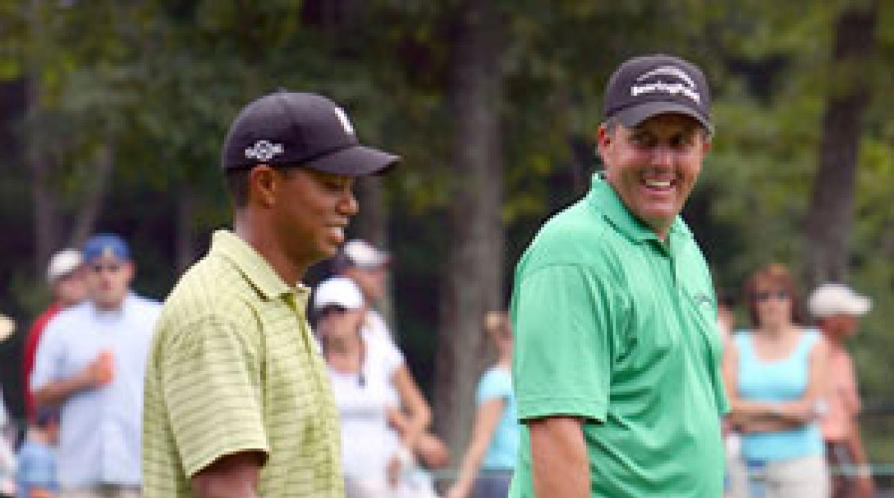 Phil Mickelson and Tiger Woods combined to shoot even par.