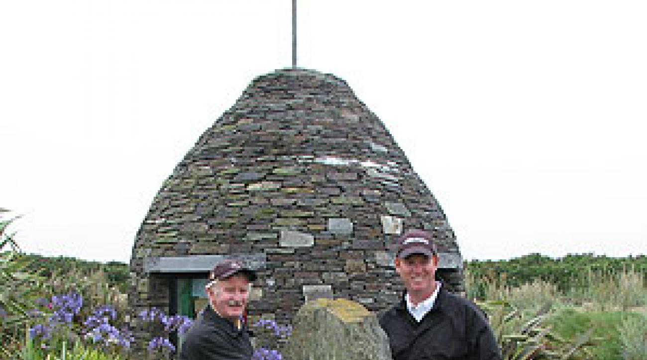 Tom Coyne shakes hands with an Old Head legend, starter Paddy Brassil through the Celtic Stone of Accord.
