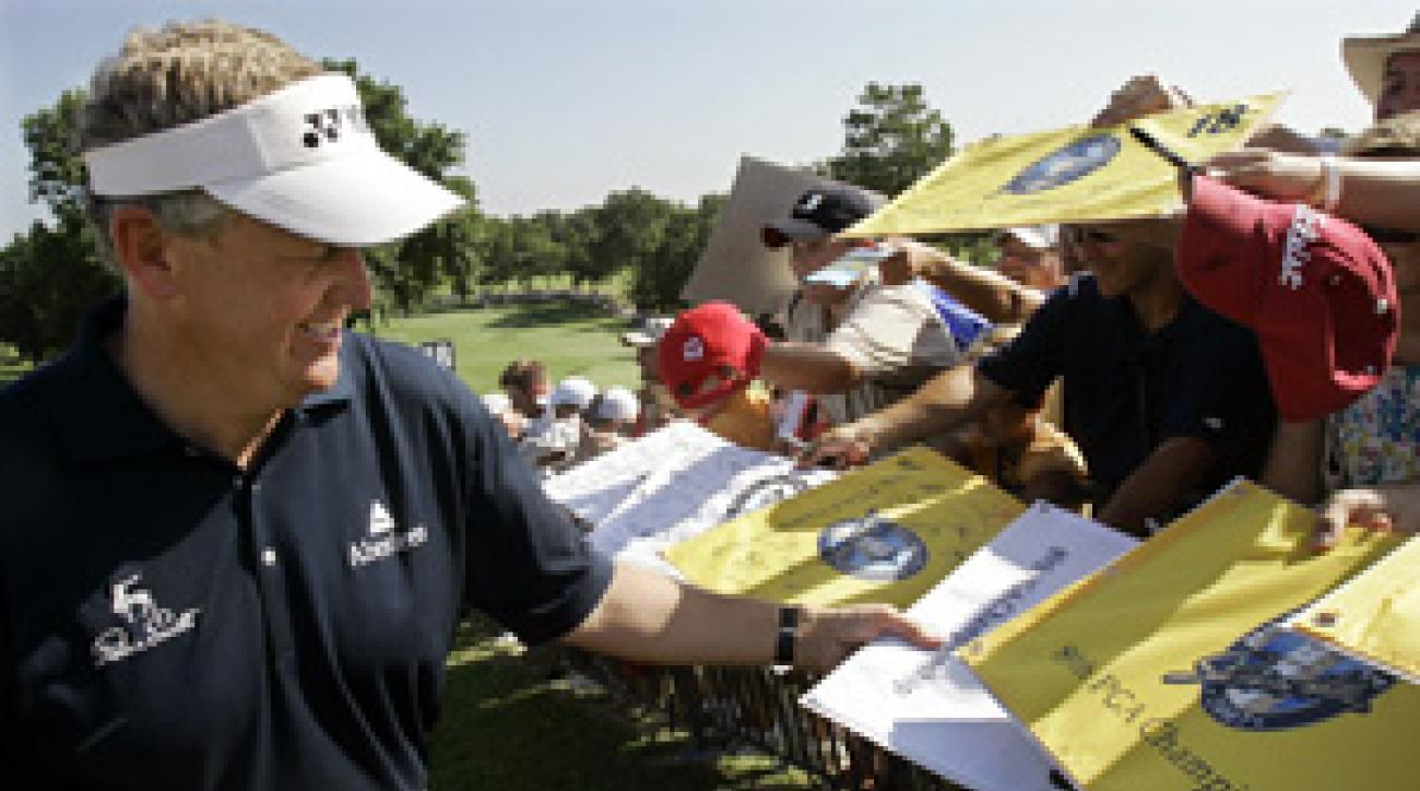 Colin Montgomerie signed autographs after his practice round Wednesday.