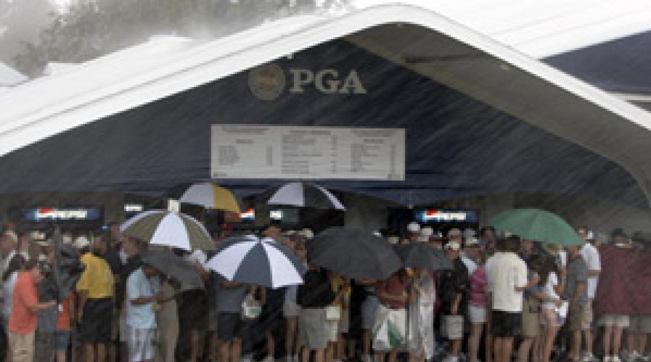 Spectators huddled under shelter as thunderstorms pounded Oakland Hills.
