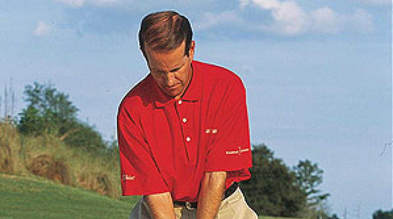 The club shaft is roughly parallel to your left leg.