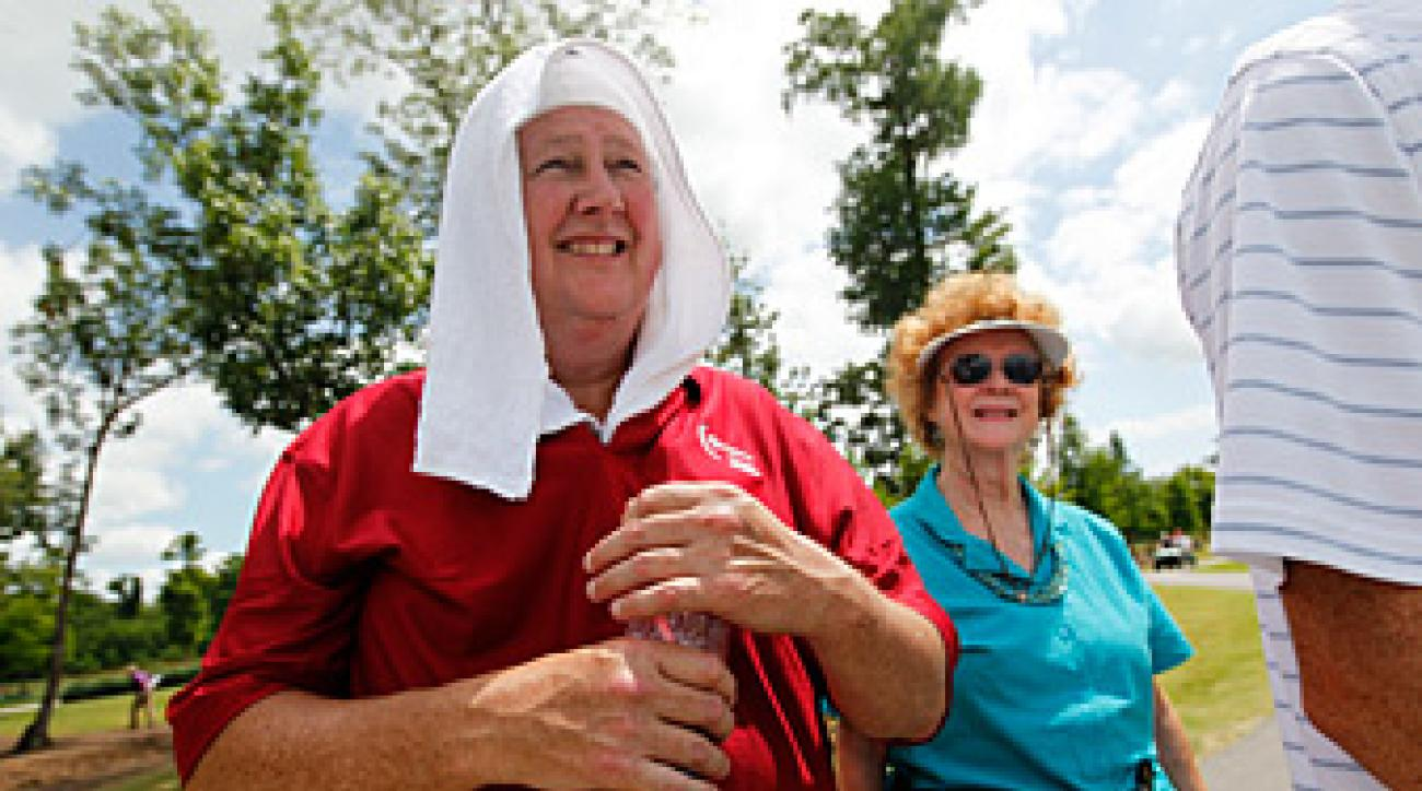 Radd Leonard, of Baton Rouge, La., wore a towel over his bandages after being hit in the head by Bubba Watson's drive.