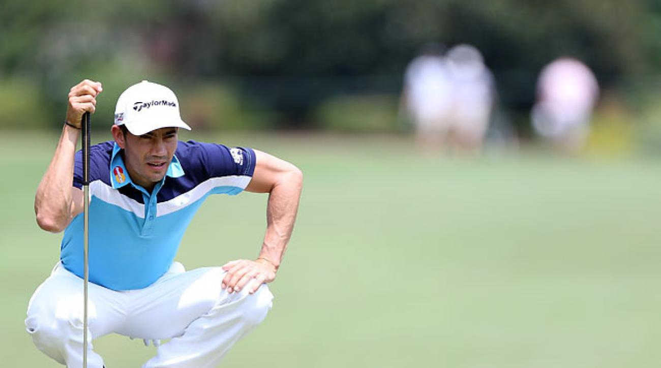 Camilo Villegas lines up a putt on the first hole in the final round of the Wyndham Championship on Sunday.