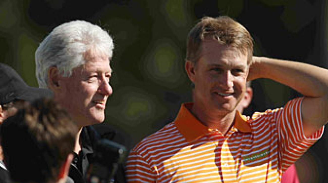 Bill Clinton chatted with David Toms during the first round of the Humana Challenge.