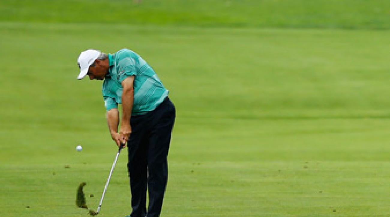 Fred Couples made seven birdies through 11 holes in the rain-delayed second round.