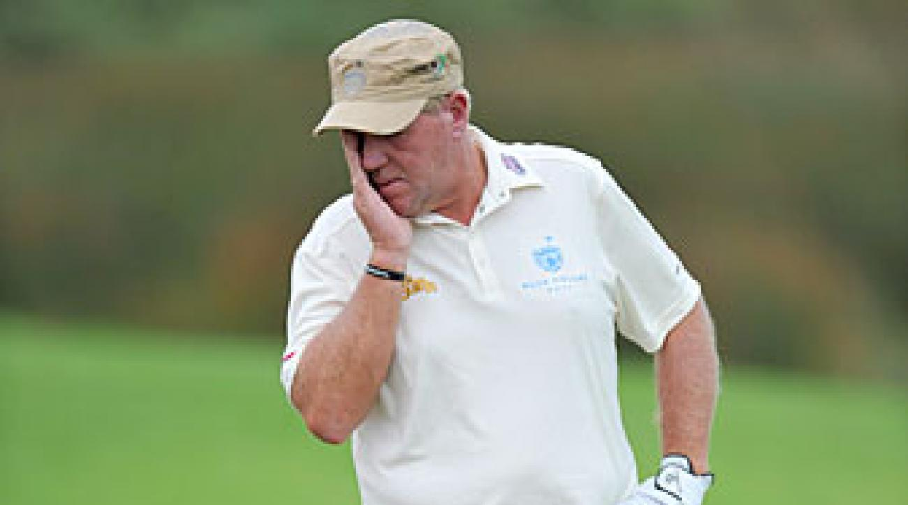 John Daly hit seven balls in the water before walking off the course.