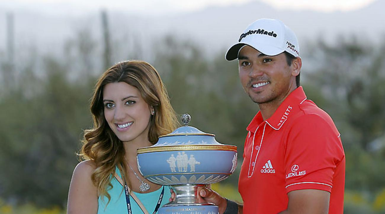 Jason Day, with his wife, Ellie, after winning his championship match against Victor Dubuisson during the Match Play Championship golf tournament Sunday in Marana, Ariz.