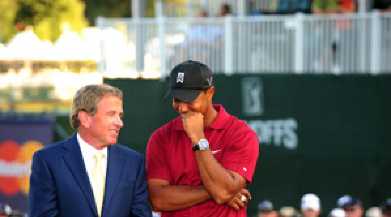 Tim Finchem, left, with Tiger Woods in September.
