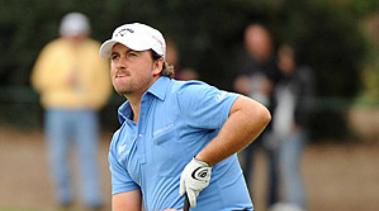 McDowell made two clutch birdie putts on 18, one in regulation and one in the playoff, to defeat Tiger Woods.