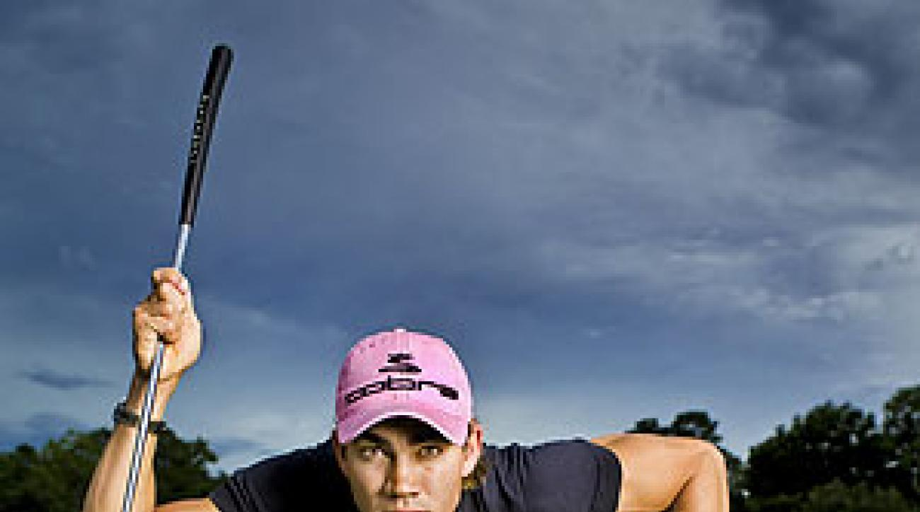 """Going low: The """"Spider-Man"""" pose Villegas uses to read greens has become his signature."""