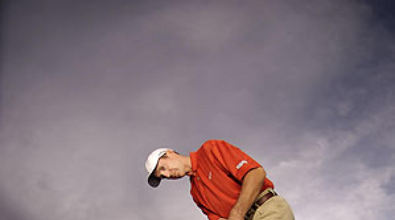 Hinge your wrists slightly going back and keep them hinged forward to produce the right type of stroke. Keep the shaft and left arm in a straight line — never let the putterhead pass your hands.
