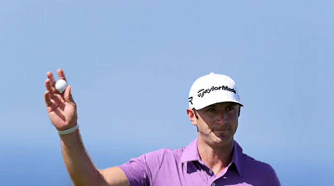 After two days of wind delay, Dustin Johnson jumped out to the lead.