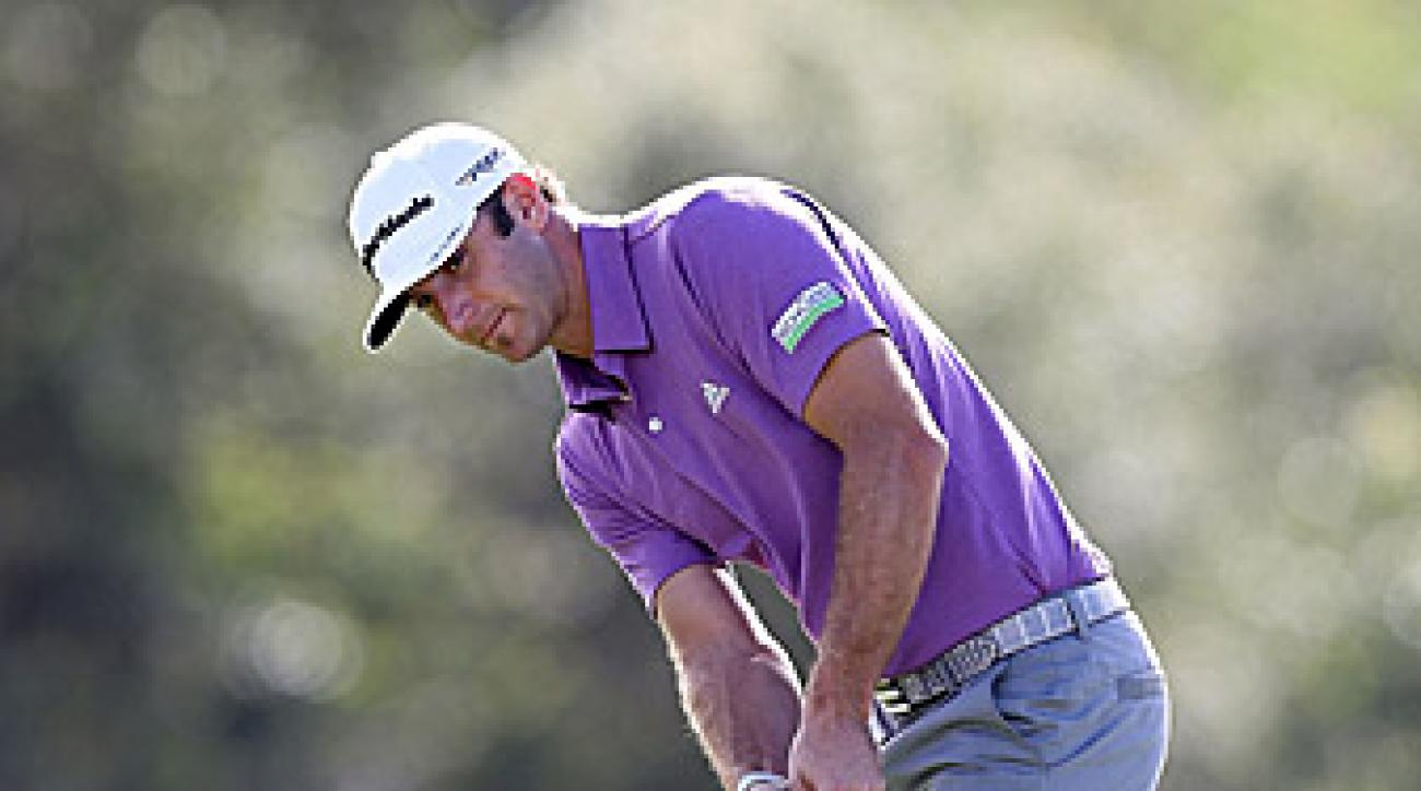 Dustin Johnson was a combined 11 under through 36 holes on Monday.