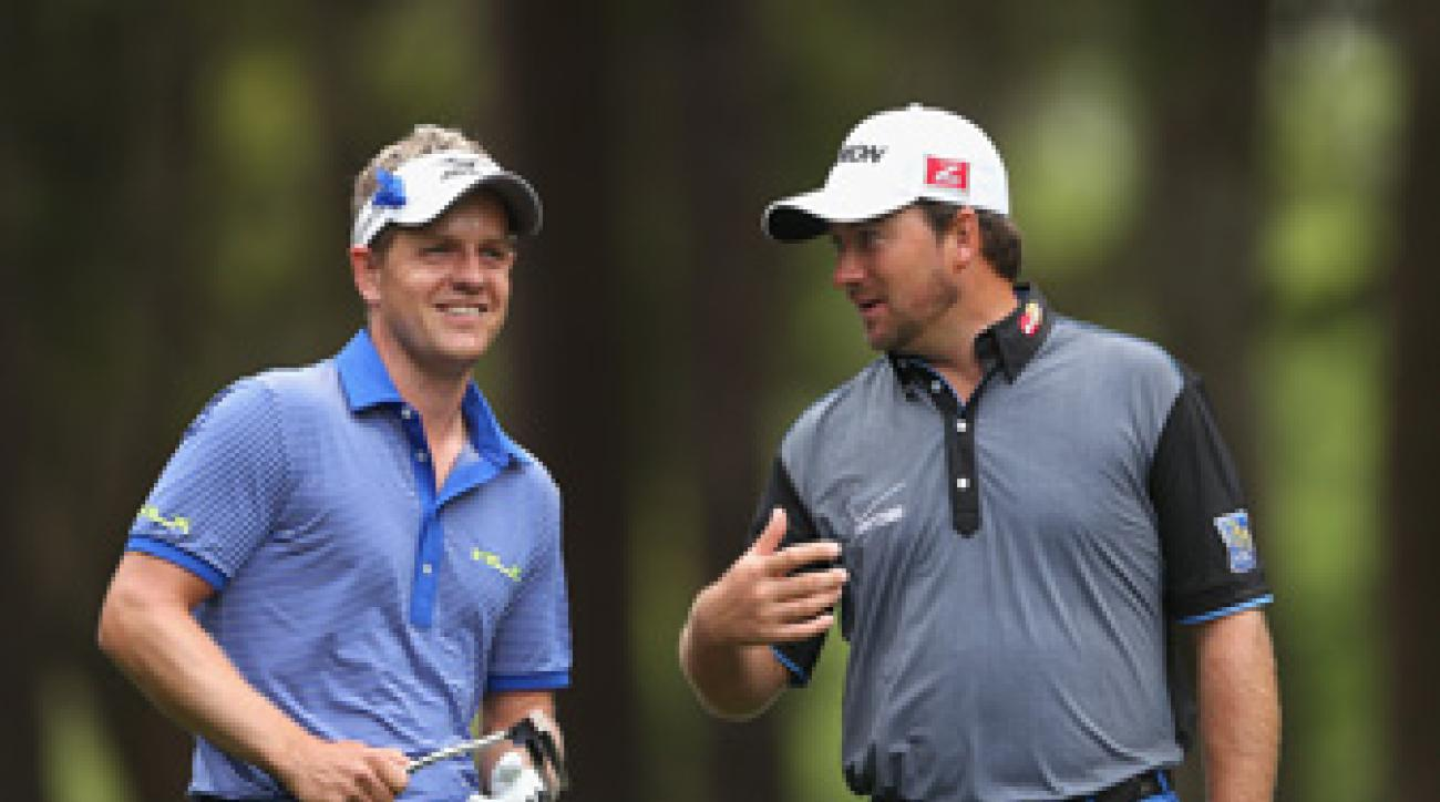 Luke Donald, left, and Graeme McDowell are in the mix heading into the weekend.