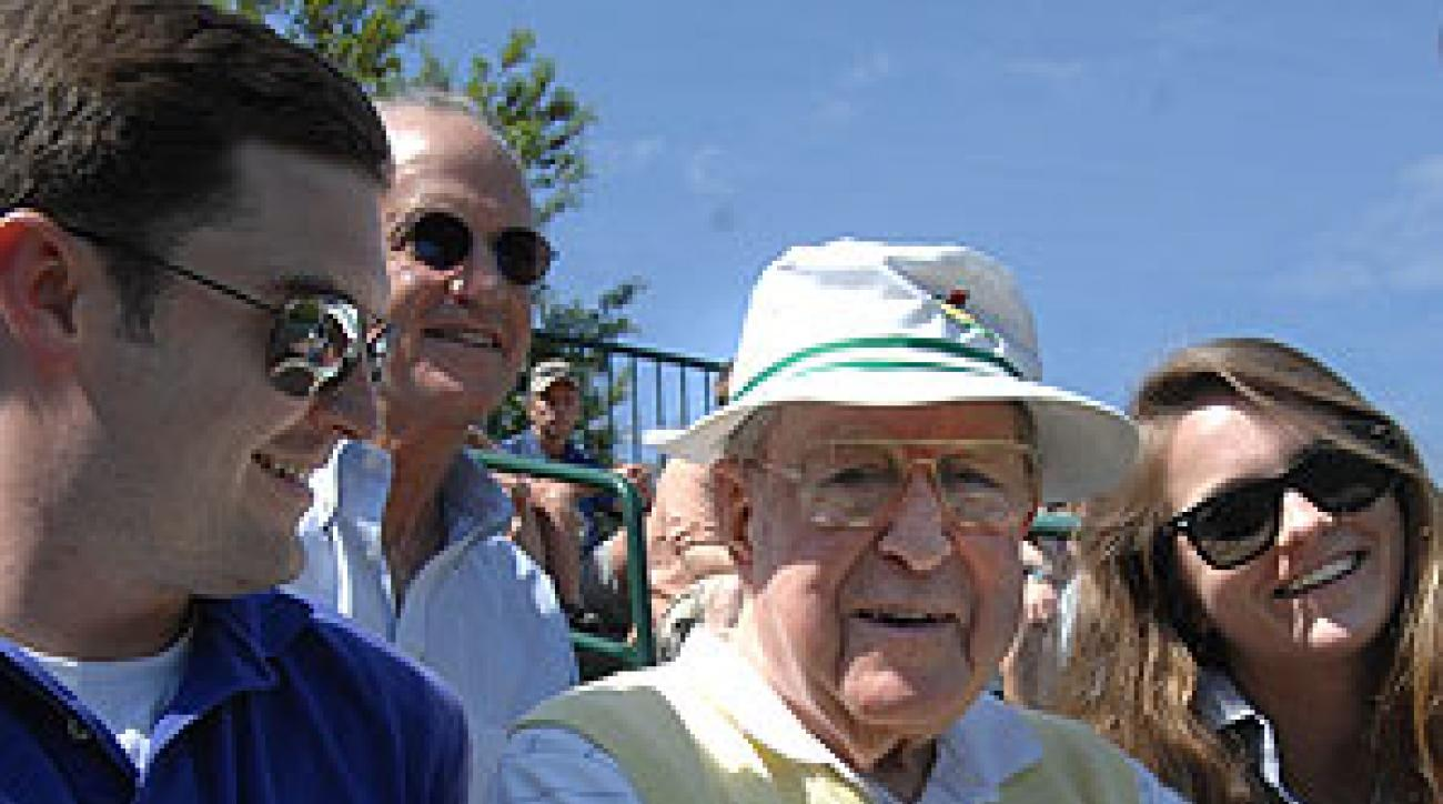 Bailey takes in the action with his grandchildren Caldwell, left, and Larkin.