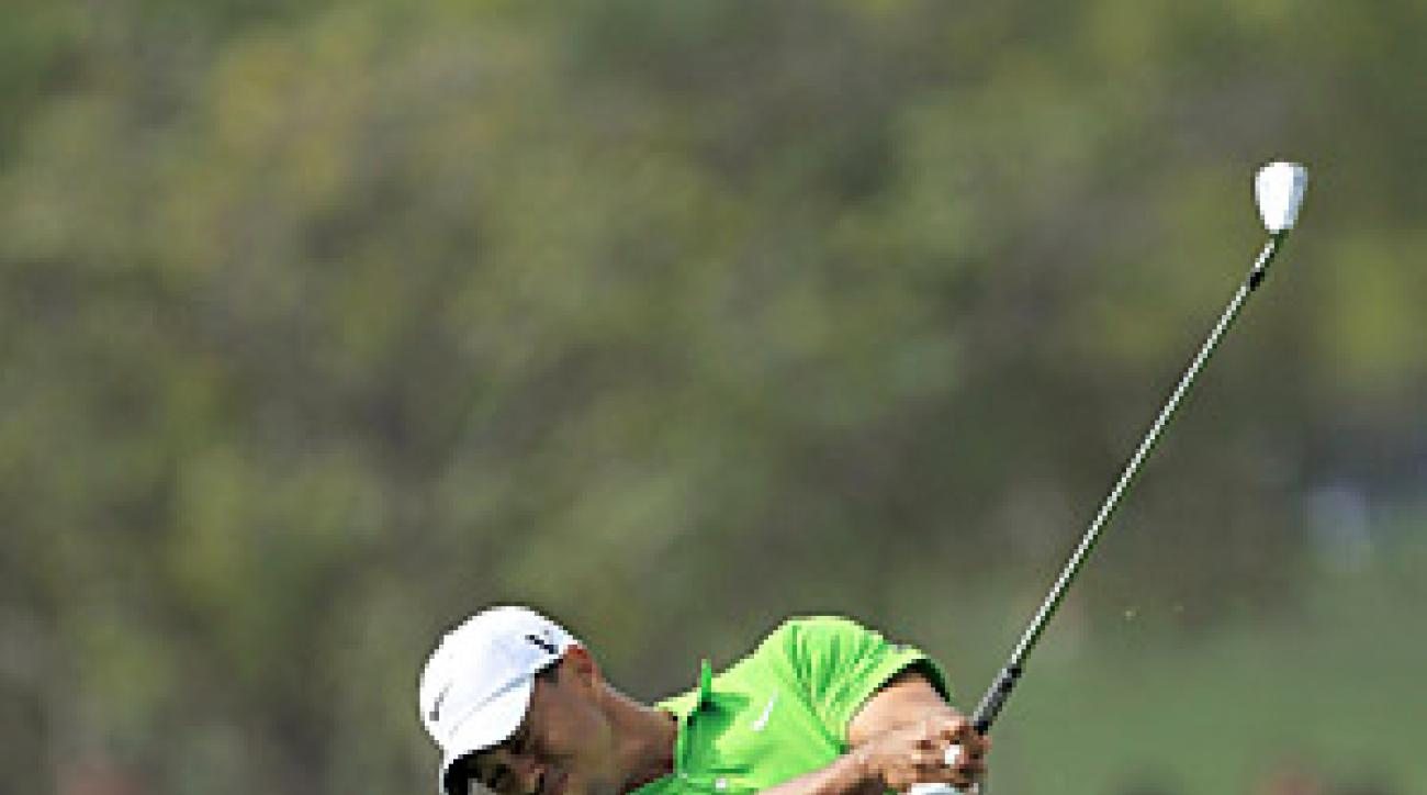 Woods climbed into contention with a six-under 66 on Friday.