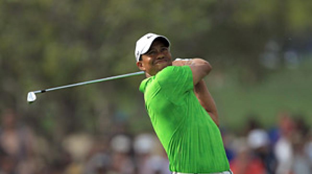 Woods fired a six-under 66 to move into contention Friday in Dubai.