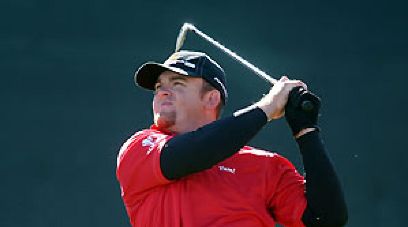 J.B. Holmes, the 2006 champion, moved into a tie for the lead after a bogey-free 65.