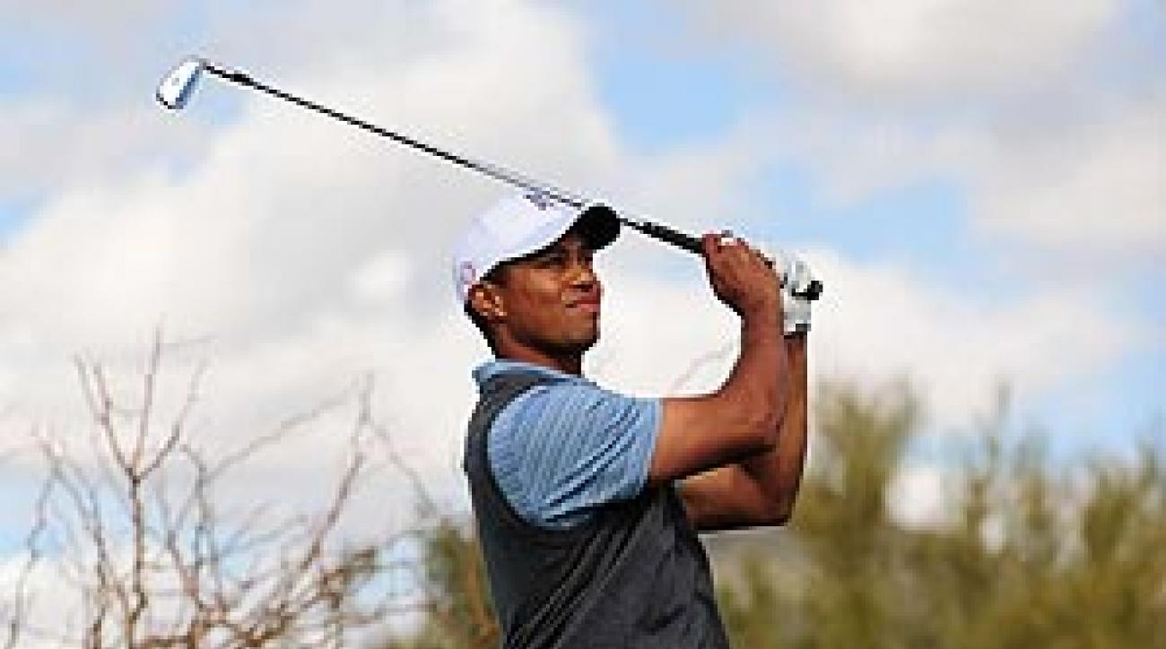 Tiger Woods defeated Arron Oberholser, 3 and 2.