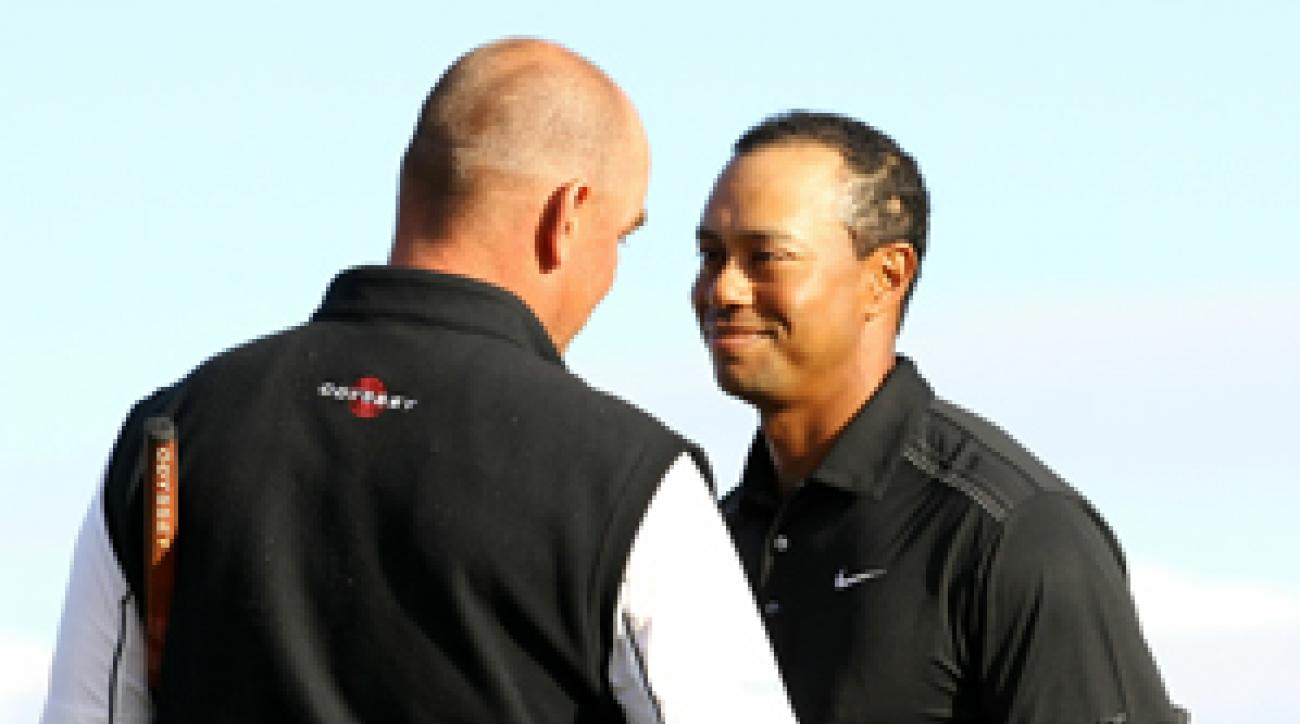 Tiger Woods, right, lost to Thomas Bjorn in 19 holes.