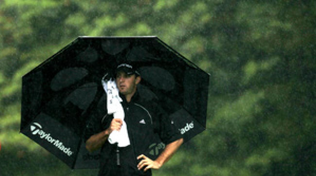 Dustin Johnson made an ace, two birdies and a bogey before play was suspended.