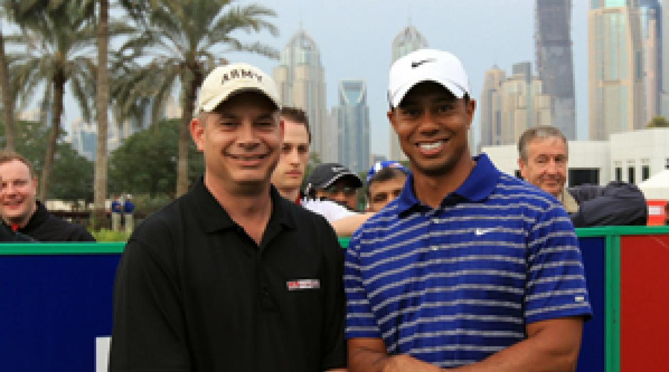 Lt. Col. Michael Rowells, left, flew in from Afghanistan to play in a pro-am with Tiger Woods.