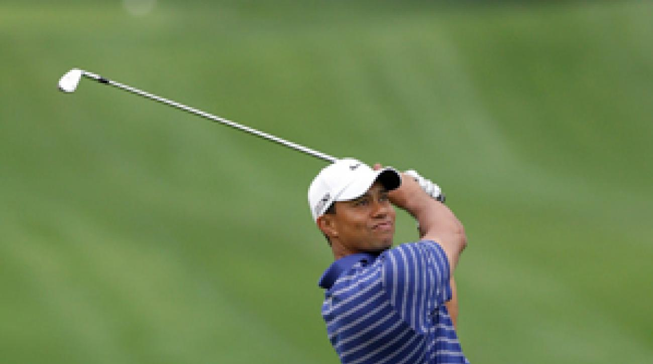 Tiger Woods says despite his struggles he is close to winning again.