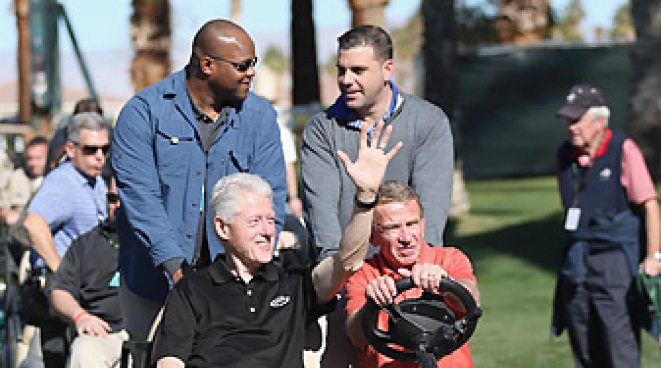 Tim Finchem (right, driving) with former president Bill Clinton at the 2013 Humana Challenge.