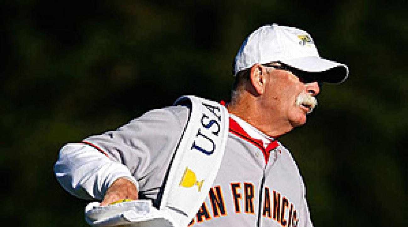 "The U.S. caddies, including Jim Furyk's caddie Mike ""Fluff"" Cowan, wore San Francisco Giants jerseys on Wednesday."
