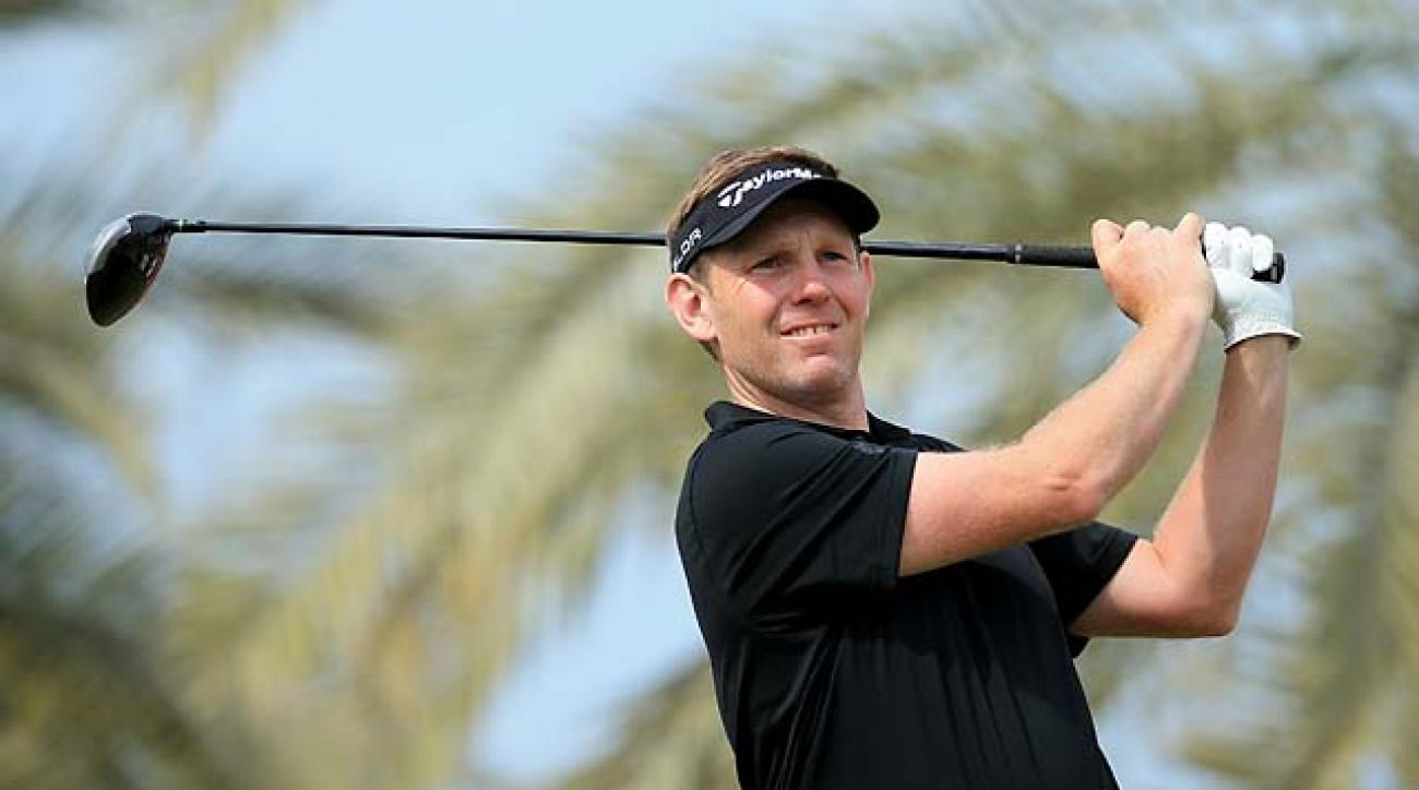 Stephen Gallacher of Scotland plays his tee shot at the par 5, third hole during the final round of the 2014 Omega Dubai Desert Classic.