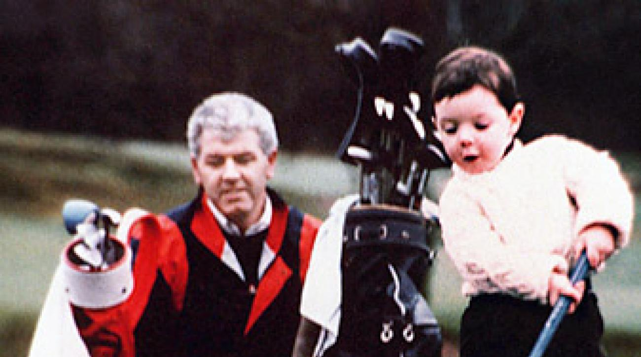 PROUD PAPA: Even as a toddler, Rory showed serious promise. Gerry would go on to work 90-hour weeks to cover Rory's golf expenses.