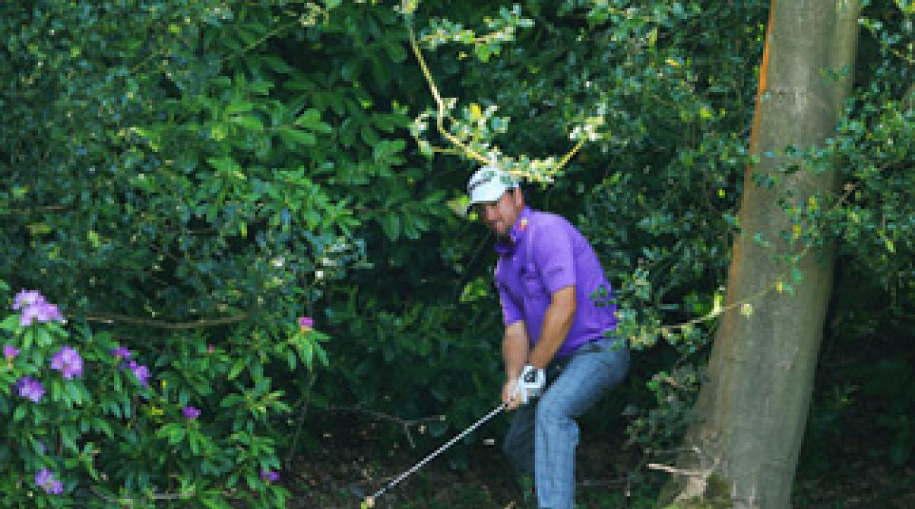 Graeme McDowell was penalized two strokes after his ball moved and he didn't replace it.
