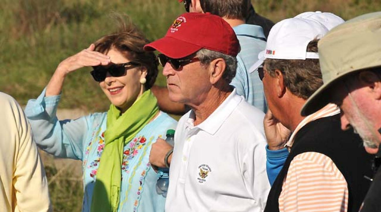 Former President George W. Bush watches the Walker Cup on Saturday at National Golf Links with his wife, Laura. Bush's great-grandfather, George Walker, founded the event.