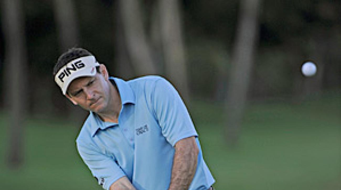 Mark Wilson hung on to his lead to claim his third PGA Tour victory.