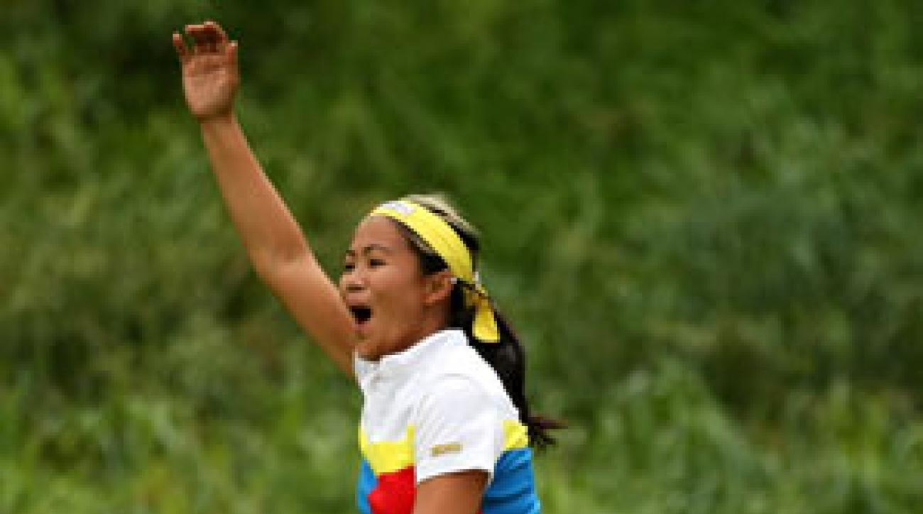 Jennifer Rosales celebrates the Philippines victory at the Women's World Cup of Golf.