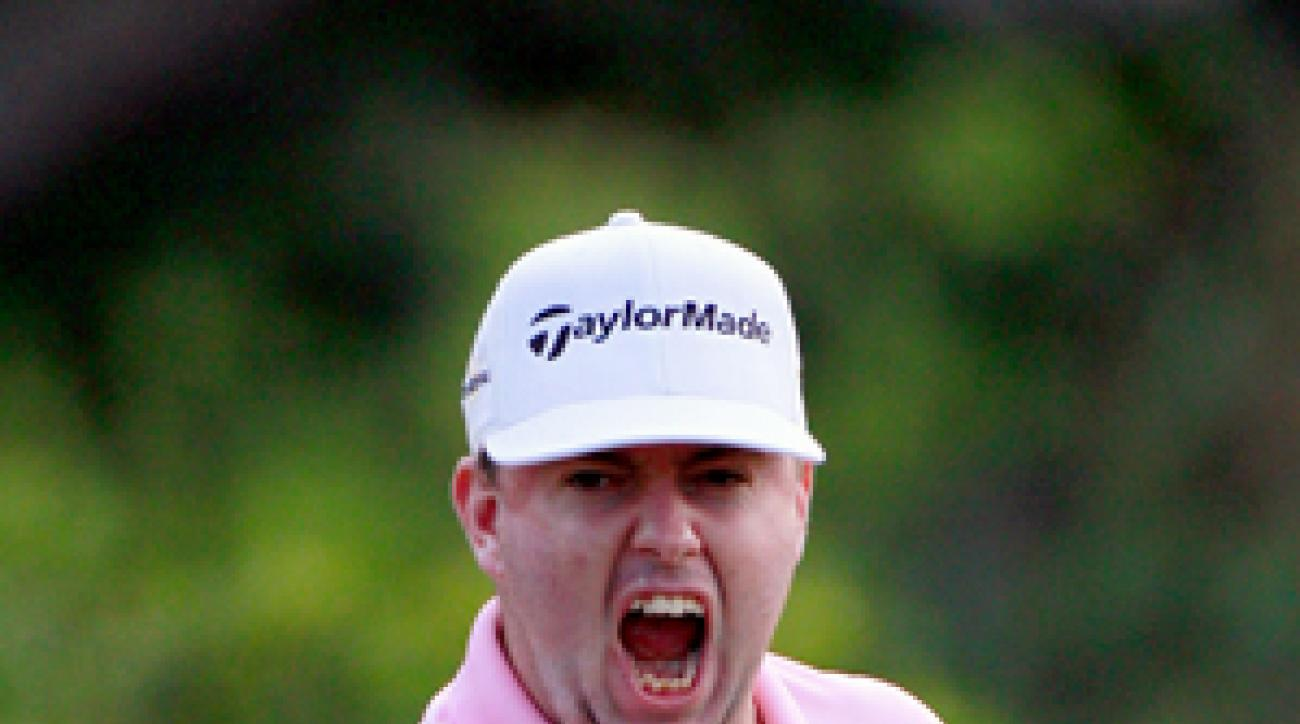 Robert Garrigus made an eagle on 18 for a share of the lead.