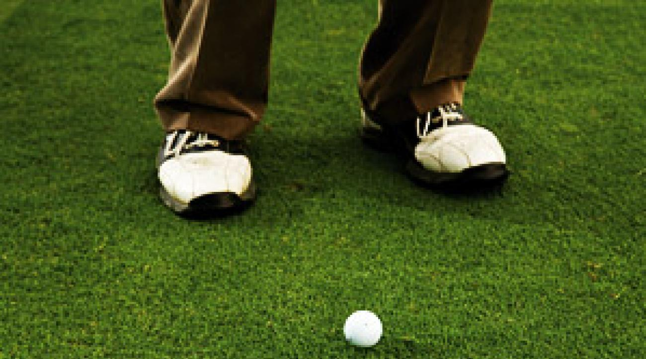Position the ball like normal, brush the ground, and leave a scuff, not a divot.