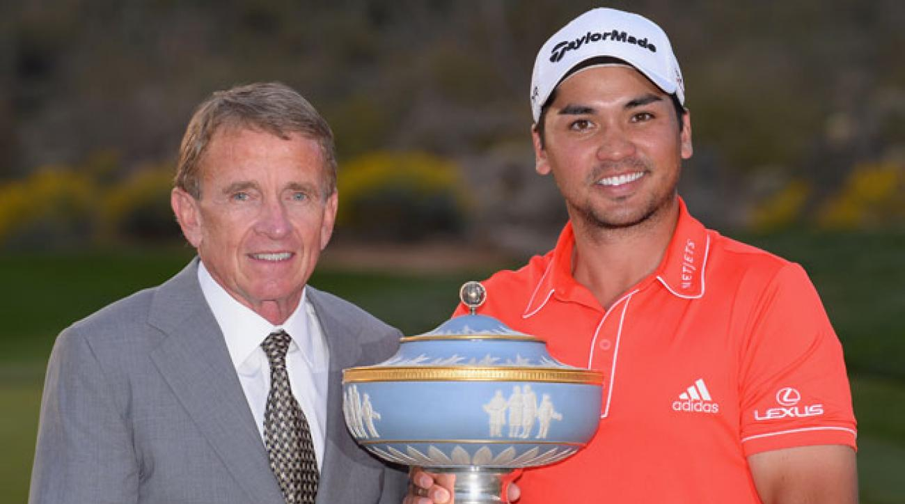 PGA Tour Commissioner Tim Finchem awards the 2014 Match Play trophy to Jason Day.
