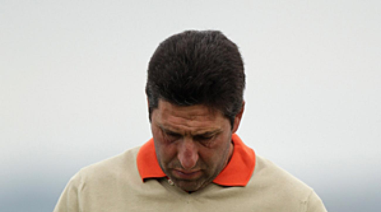 Jose Maria Olazabal pinned a black ribbon to his cap before the start of the third round of the Spanish Open.