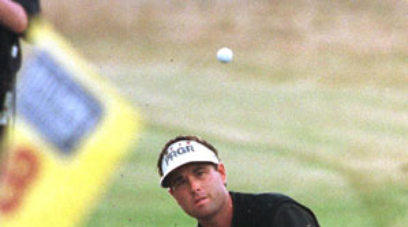 Brian Watts hitting the bunker shot on 18 that helped get him into a playoff with Mark O'Meara in '98.