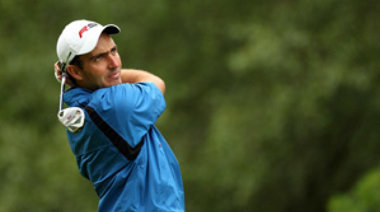 Edoardo Molinari birdied four of the last five holes to move ahead of Darren Clarke.
