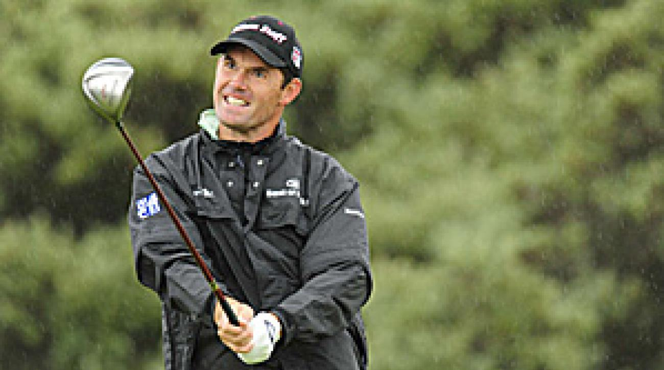Harrington wasn't even sure he'd be able to tee off, but he made the turn at one over despite brutal conditions.