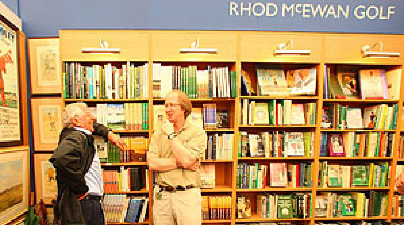 Rhod McEwan, right, chats with a customer in the book shop.