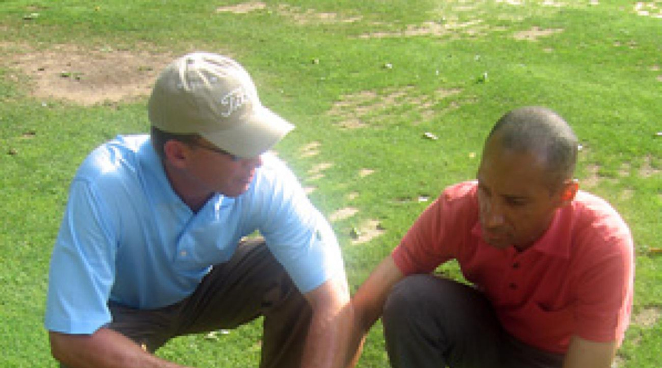 Michael Breed, left, talks with Suleiman Rifai during a practice session.