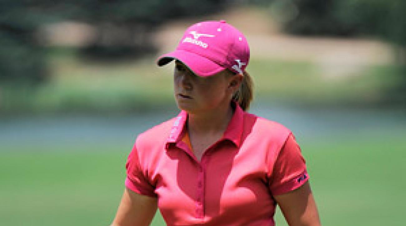 Stacy Lewis led all day until she surrendered three strokes following the evening rain delay.