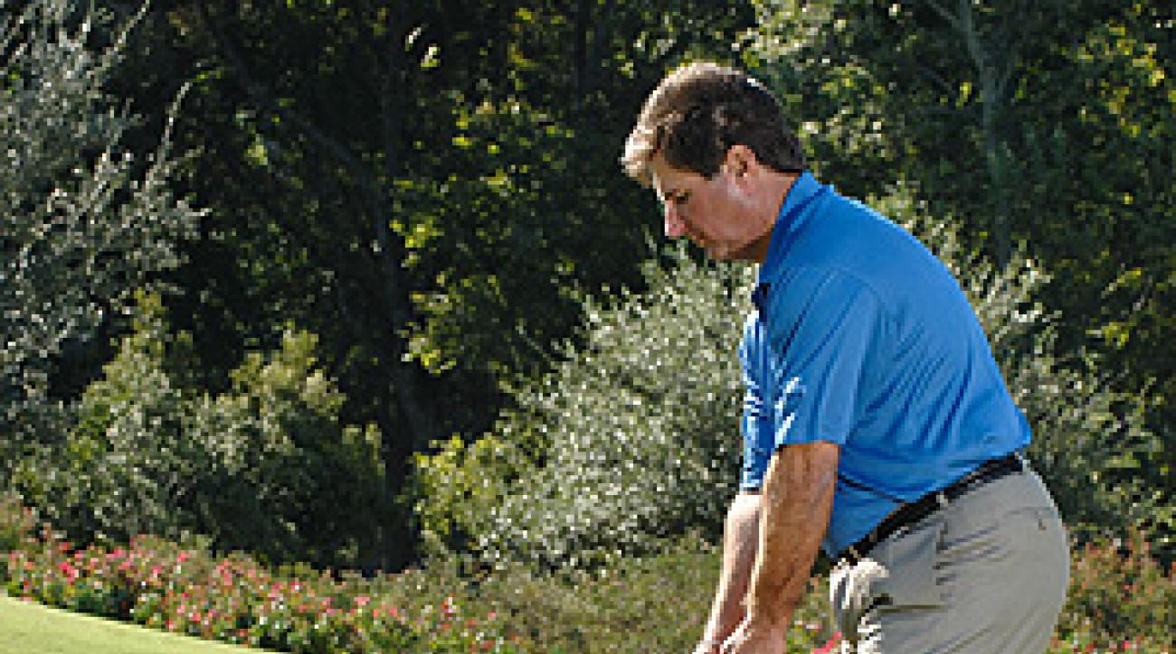 From a steep sidehill lie, the face of a mid-iron will point slightly left of the target.