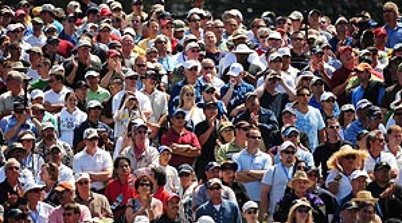 Spectators swelled around the Woods-Mickelson-Scott grouping.